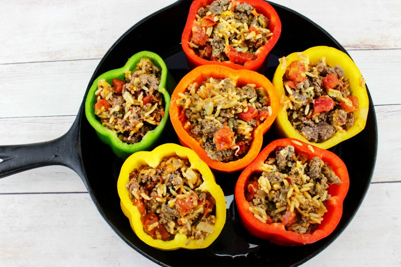 Taco Stuffed Peppers, Your family will eat this Taco Stuffed Peppers Recipe up! and Love it Ground Beef Recipes, Mexican Stuffed Peppers, These stuffed peppers are full of a delicious filling made with seasoned ground beef, rice, topped with cheese, baked inside sweet bell peppers.