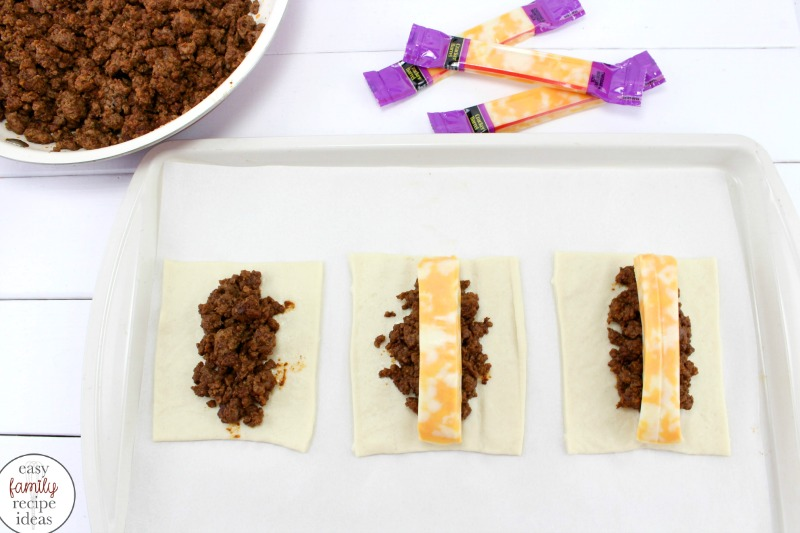 Taco Roll Ups,These easy Cheesy Taco Roll Ups are delicious dough filled with taco meat and lots of cheese! Perfect for snacking, watching football, or an easy family dinner idea.Taco Roll Ups with Pizza Dough, Cheesy Taco Sticks, Ground Beef Recipes