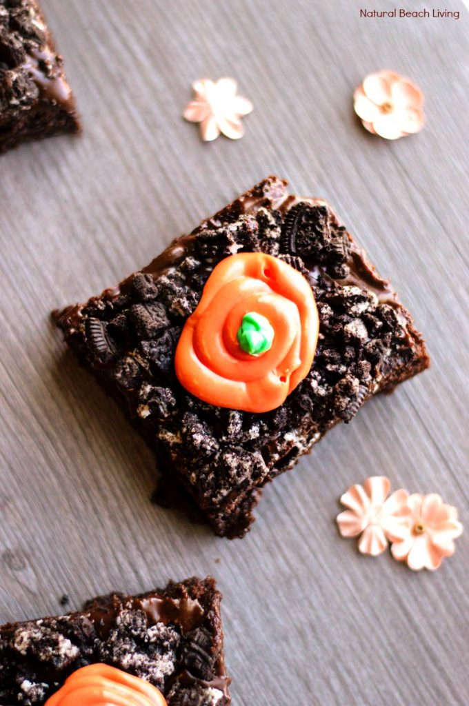 "This Oreo Brownies Recipe is so good! They're chocolatey, with a cookie crumble and a little""carrot"" on top that makes them so irresistible. Bake a batch of these easy chocolate brownies for the perfect Easter treats. Carrot Patch Brownies, Easter Brownies, Carrot Brownies,"