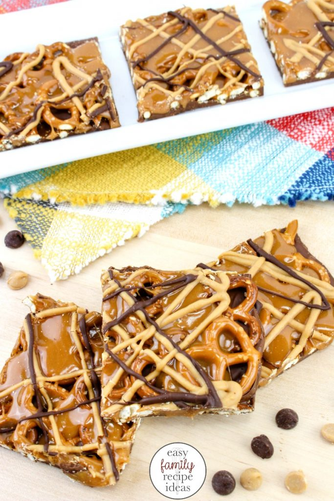 These Chocolate Caramel Pretzel Bars are AMAZING! Smooth chocolate with crunchy salty pretzels and a caramel drizzle chocolate bark. Yum! This Easy Chocolate Pretzel Bars Recipe is delicious. No Bake caramel pretzel crack bars are the perfect Treat