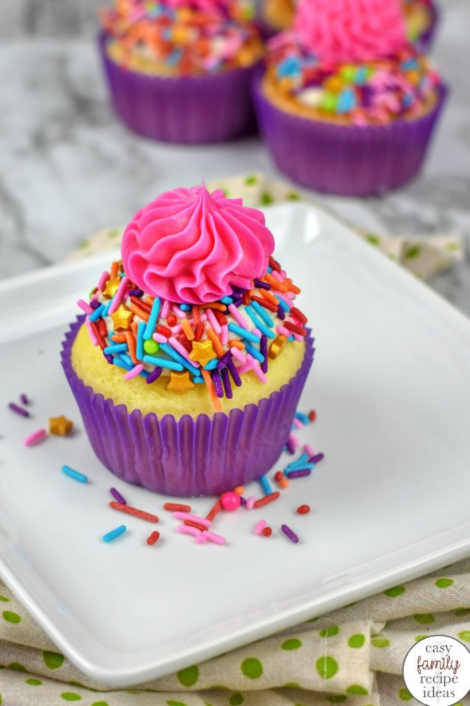 These Easy Unicorn Cupcakes are perfect for Birthday Party Food and so much fun to eat. Tasty Vanilla cupcakes stuffed with sprinkles, This unicorn cupcakes recipe can be made by kids and adults, Stuffed Unicorn Cupcakes