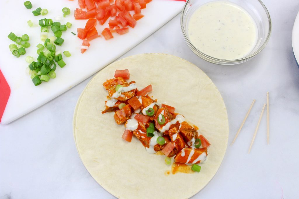 These Buffalo Chicken Wraps are so good and perfect for a summer lunch or dinner idea. Shredded Buffalo Chicken Wraps, These Buffalo Ranch Chicken Wraps only take 5 minutes to make and are full of tasty flavor, Easy and Healthy Buffalo Chicken Wrap everyone will love!