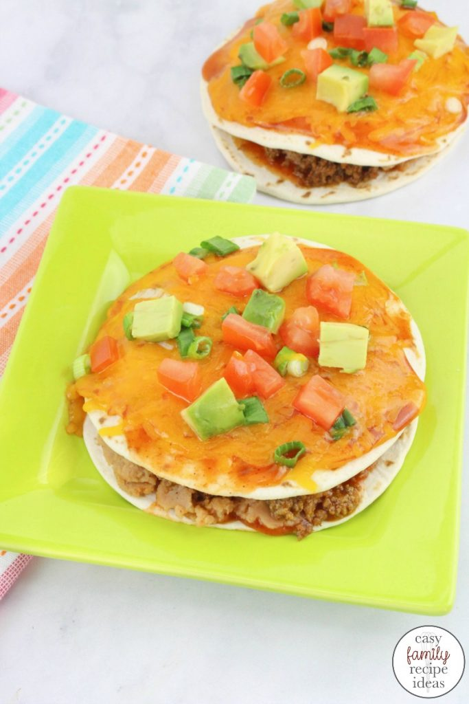 Taco Pizza Recipe, Mexican Pizza Stacks, Stacked Tortilla Taco Pizzas are baked in the oven covered with lots of delicious melted cheese and they taste amazing. Serve this yummy taco pizza with your favorite Taco Stuffings for a delicious Mexican pizza.