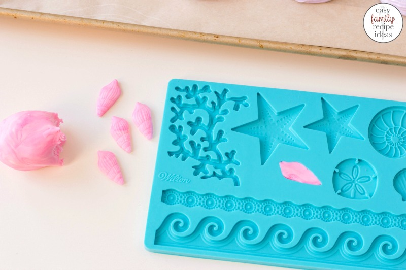 These Beach Themed Meringue Cookies make Perfect under the sea cookies that are yummy and perfect birthday party treats or summer wedding snacks. Easy Ocean Themed Meringue Cookies make great Mermaid Party Food Ideas