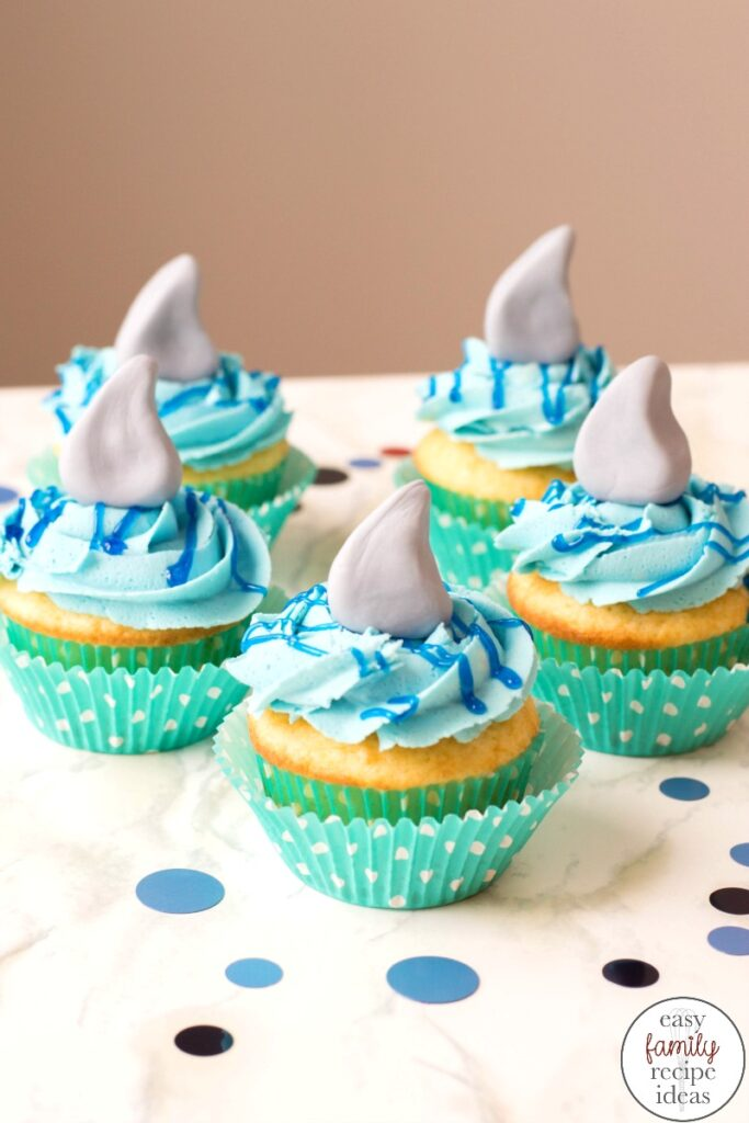 These shark cupcakes are tasty treats everyone will want to take a bite of. Learn how to make shark week cupcakes with this easy recipe and tips for the best ocean theme dessert. Baby Shark Cupcakes