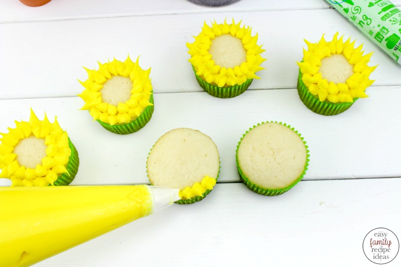 Sunflower Cupcakes are perfect for a Birthday party, Baby shower, or a Garden party! There are many ways to make delicious sunflower cupcakes but I wanted something easy and pretty that anyone could pull off. Easy Flower Cupcakes for Spring or Summer Dessert.