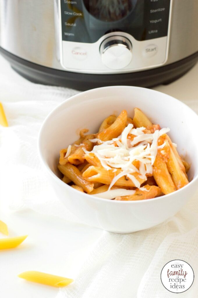 This delicious Instant Pot Chicken Pasta is an easy dinner recipe and takes 20 minutes to make. Your family will think this is one of the Best Chicken Recipes, Instant Pot Cheesy Chicken Pasta,  Easy Family Recipes, Chicken and Penne Pasta Recipes,