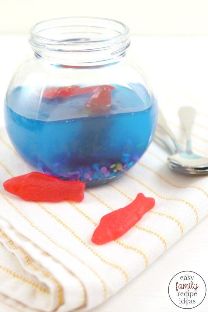 This yummy Jello Ocean is a Perfect Snack for a summer pool party or under the sea birthday party,  Your friends will love this Jello Aquarium Swedish fish recipe that looks awesome and is easy to make. Ocean Jello, Under the Sea Jello, Jello Ideas for Birthday Parties