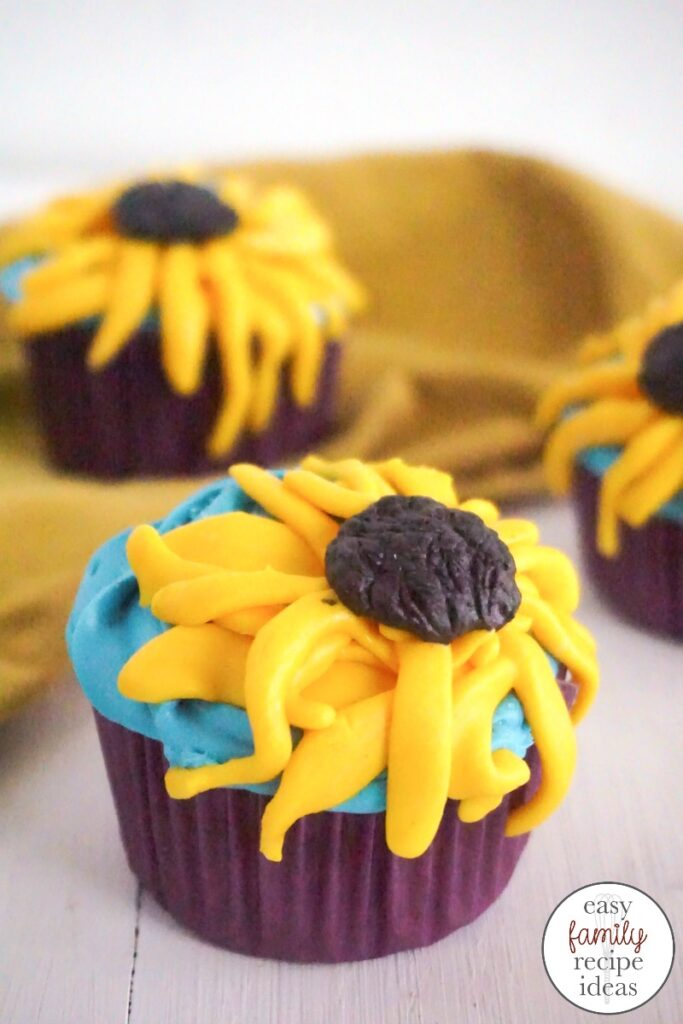 These Frozen Cupcakes Inspired by Anna are so perfect and just in time for the new Frozen movie! These Sunflower Cupcakes are so delicious and simple, You can use a Box Cake Mix and have these Anna Cupcakes done in less than 30 minutes. Perfect for a Frozen Birthday Party or Garden Theme. Frozen Cupcake Ideas