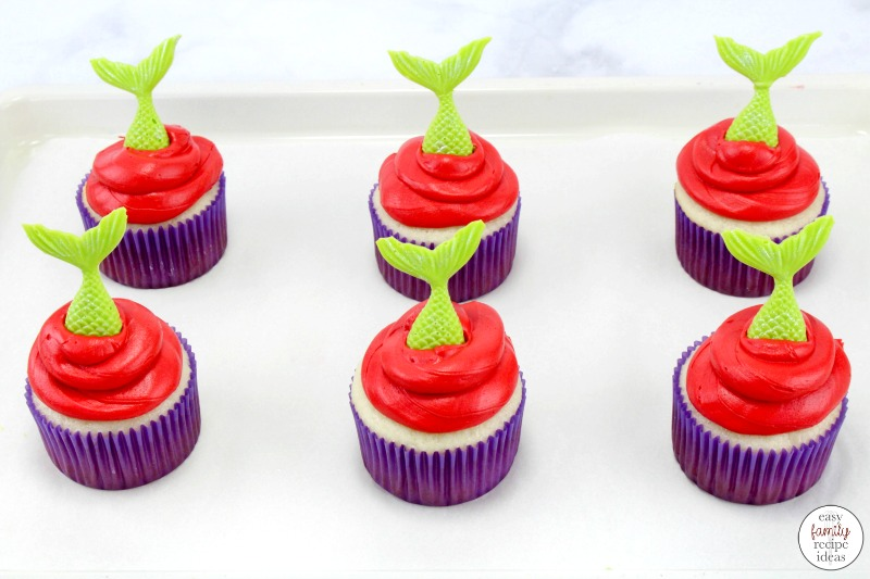 These Little Mermaid Cupcakes are so simple and easy to make. Perfect for a Disney birthday party or a mermaid party as well! These Mermaid Cupcakes are easy to decorate and taste great too. If you're looking for a super simple addition to a Little Mermaid themed party, these mermaid cupcakes are perfect!