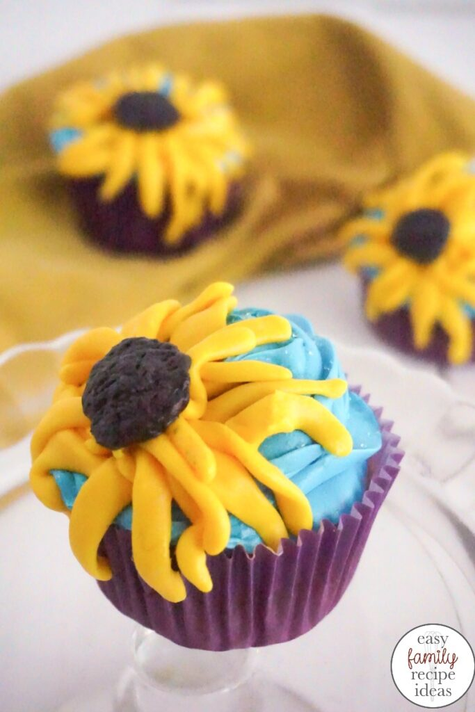 These Frozen Cupcakes Inspired by Anna are so perfect and just in time for the new Frozen movie! These Sunflower Cupcakes are so delicious and simple, You can use a Box Cake Mix and have these Anna Cupcakes done in less than 30 minutes. Perfect for a Frozen Birthday Party or Garden Theme.