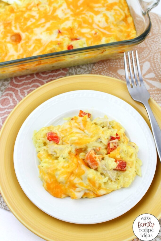 This simple Cheesy Chicken and Rice meal is a great Easy Dinner Recipe for busy families. Super simple to make and so tasty, too! Easy Cheesy Chicken & Rice, This is a 30 minutes or less easy family recipe idea kids and adults love to eat. Baked Chicken and Rice Casserole is Delicious!