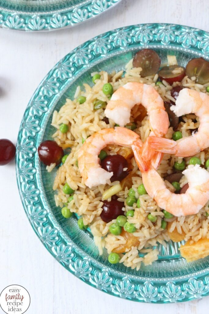 Easy Shrimp and Rice is a delicious and fruity recipe your kids can make. The fresh fruit and jasmine rice adds an amazing flavor to this quick and incredibly delicious dinner recipe. Kid Made Fruity Rice is a go-to 15-minute meal. It's perfect for a quick and easy lunch idea or simple dinner recipe.