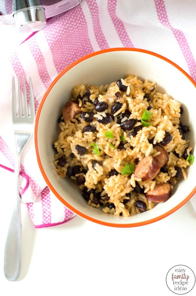This Instant Pot Rice and Beans Recipe is so simple and easy to make. This is one dish that your entire family is going to request! A delicious hearty bowl of rice and beans sausage that takes 30 minutes or less to make. Easy Rice and Beans is full of protein and flavor that will keep you coming back for more!