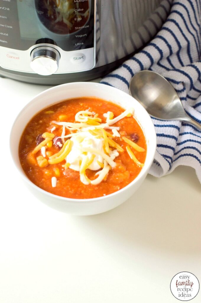 Cook up this Instant Pot Vegetarian Chili Recipe for a cold winter day. This Vegetarian Chili is Hearty and filling you don't need any meat to satisfy you. An Easy Instant Pot Chili that everyone Loves!