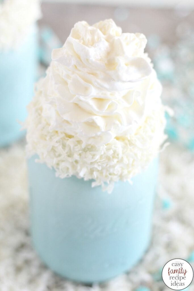 "This Disney Frozen Themed Milkshake recipe is the perfect easy snack. And who doesn't love the taste of a delicious and creamy milkshake? Not only is it ""cool"" and yummy, but it's a festive Winter Wonderland Blue Milkshake for a fun winter snack. This Frozen inspired Milkshake is perfect for a Frozen Themed Party Food at your next Frozen birthday party or movie night."
