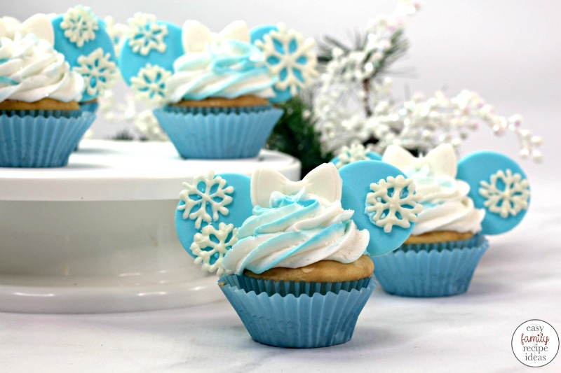 You're going to really love the look and taste of these Disney Frozen Cupcakes. They are so much fun to create and a tasty treat to eat! Frozen Themed Cupcakes starts with an easy boxed cake mix recipe. Frozen Cupcakes are great for a movie night snack or Frozen Themed Birthday party food.  Frozen Disney Cupcakes