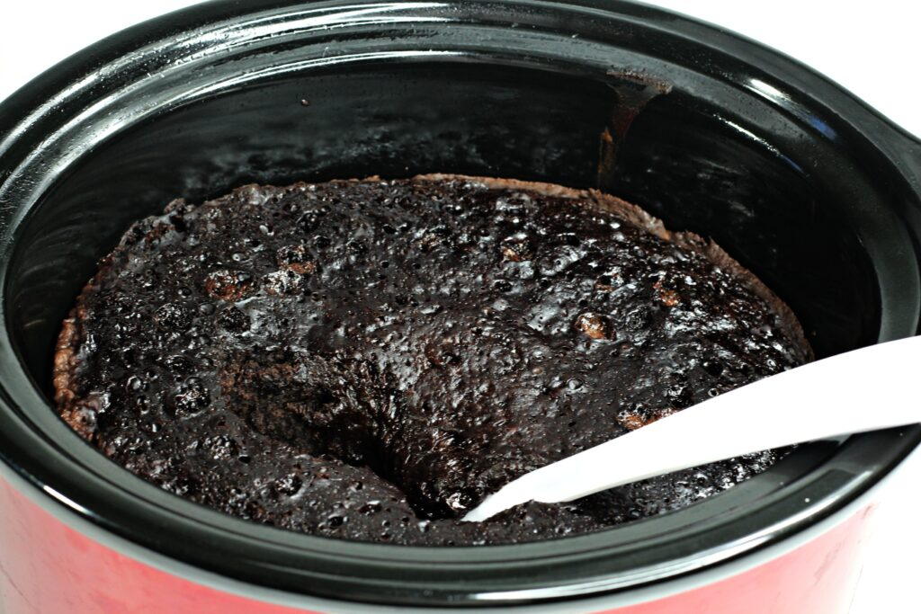 You're going to love this Slow Cooker Chocolate Lava Cake! It's as easy as adding in a few ingredients and turning on your crockpot! This Easy Crockpot Chocolate Lava Cake is so yummy and decadent your family will want you to make this all the time.