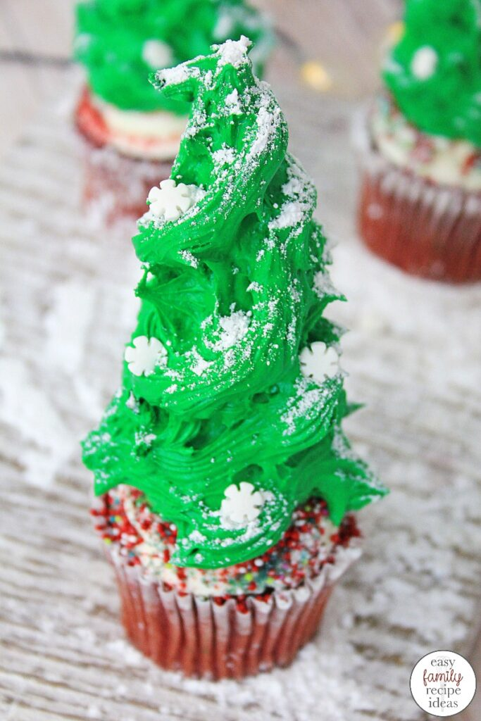 You'll be in the holiday spirit with these Christmas Tree Cupcakes! It's the perfect dessert to celebrate the holiday season! These Tasty and Easy Christmas Cupcakes will bring joy to everyone that see's and eats them. The Best Christmas Tree Cupcakes!
