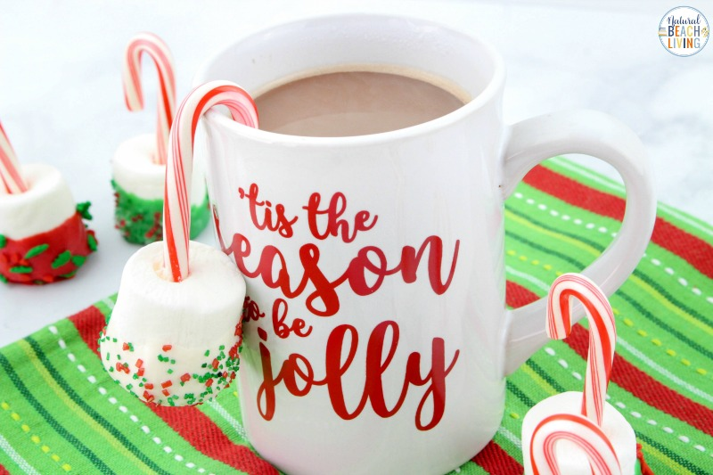 These Candy Cane Marshmallow Hot Chocolate Dippers are so simple and only have 4 ingredients! It's a quick way to make a delicious winter treat! Easy Hot Chocolate Stirrersfor a snack on a Cold Winter Day. hot chocolate dippers recipe, Peppermint hot chocolate dippers, candy cane hot chocolate dippers, candy cane marshmallow pops