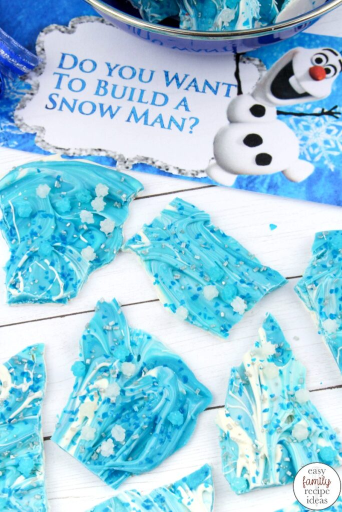 Don't miss out on this easy to make Frozen Chocolate Bark Recipe! You're going to love the taste and ease of this Frozen Themed treat! Add this Disney Frozen Chocolate Bark to a themed birthday party, or Winter Party idea #disneyfrozen #frozenthemeddessert #disneyfrozentheme #frozenbirthdayparty