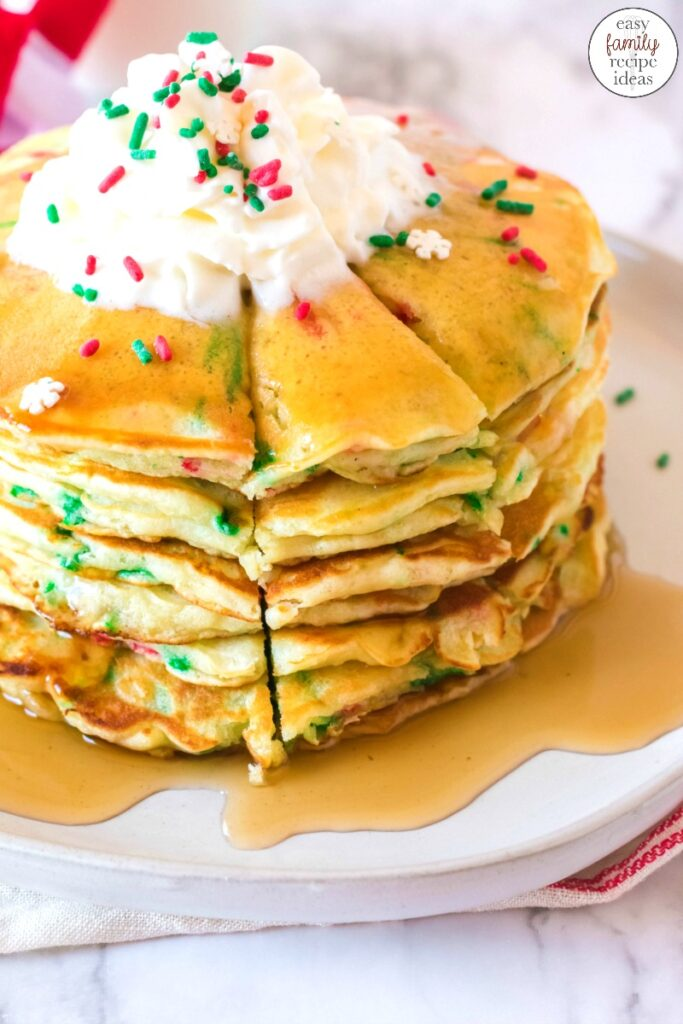 These Funfetti Christmas Pancakes are delicious and festive. Full of scrumptious flavor, color and holiday spirit, one stack of these homemade Christmas pancakes are perfect! Christmas Funfetti Pancakes, Get baking this holiday season with Elf Pancakes