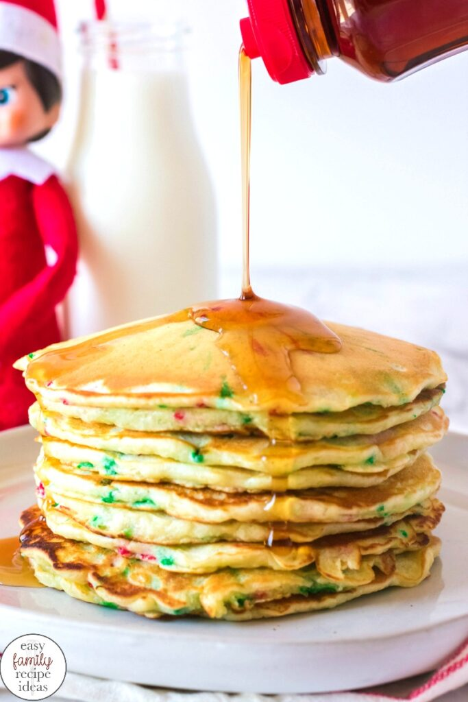 These Funfetti Christmas Pancakes are delicious and festive. Full of scrumptious flavor, color and holiday spirit, one stack of these homemade Christmas pancakes is perfect! Christmas Funfetti Pancakes, Elf Pancakes