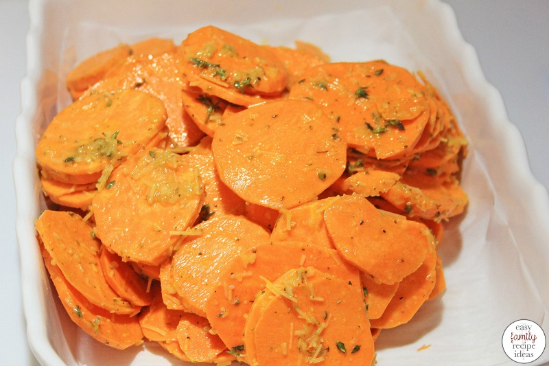 These Garlic Roasted Sweet Potatoes are the best! They're a great side dish and taste perfect with just about anything, especially a Thanksgiving or Christmas Side Dish. Plus, they're so simple to make! Baked and Healthy Easy Sweet Potato Side Dish your family will love.
