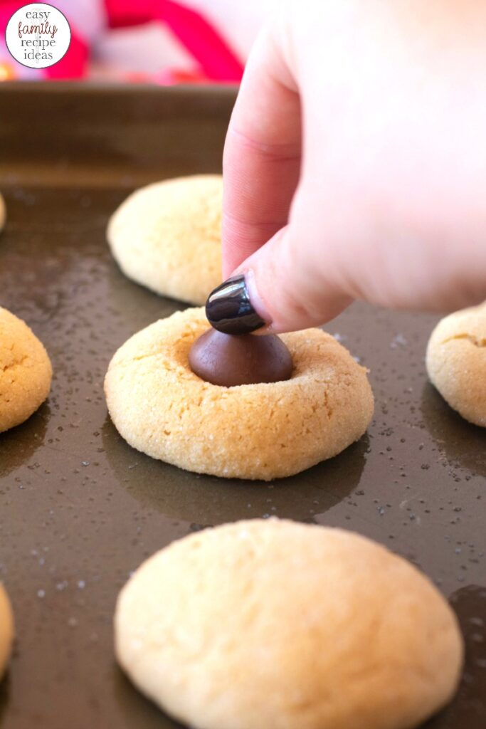 These Thumbprint Hershey Kiss Cookies are a must for the holiday season. The combination of peanut butter and chocolate is amazing! Plus everyone will love these Elf Poop Cookies for a sweet Christmas Cookie idea, Hershey kiss cookies, Peanut Butter Blossom Cookies are Delicious Any time during the year so add this easy peanut butter kiss cookies recipe to your list.