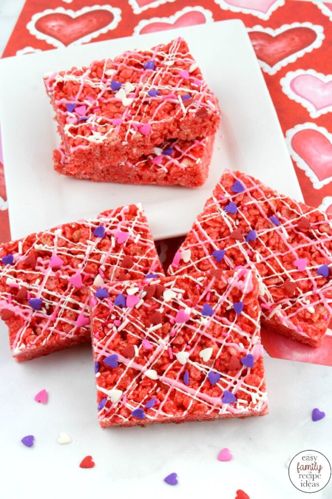 These Cherry Rice Krispie Treats are such a fun snack for Valentine's Day! The cherry flavor is a tasty surprise to your normal Rice Krispie Treats Recipe. Your kids will love the delicious taste of these Valentine Rice Krispie Treats! a simple Valentine's dessert that anyone can make and everyone loves to eat.
