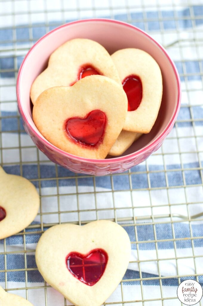 These Stained Glass Valentine Cookies are a tasty treat for Valentine's Day. Heart Cookies are such a fun and easy cookie recipe to make and share!  A handful of simple ingredients will get you the perfect Valentine's Day cookies that are tasty and beautiful.