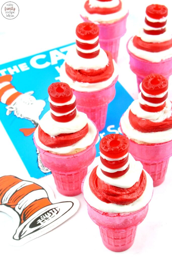 These Cat in the Hat Cupcakes are simple and fun to decorate together as a family! Read Dr Seuss books and enjoy tasty Dr Seuss Cupcakes for a treat. Perfect for Dr Seuss Food Ideas or Dr Seuss Party Food, These Dr Seuss Cat in the Hat Cupcakes are delicious, Ice Cream Cone Cupcakes for the win!
