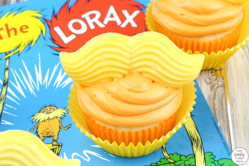 These Dr. Seuss The Lorax Cupcakes are perfect for Dr. Seuss day, Earth Day or a themed birthday party! They're a super cute cupcake decorating idea and so easy to make as well! These Lorax Themed Cupcakes are a fun and easy baking activity that the kids enjoy helping with as well.