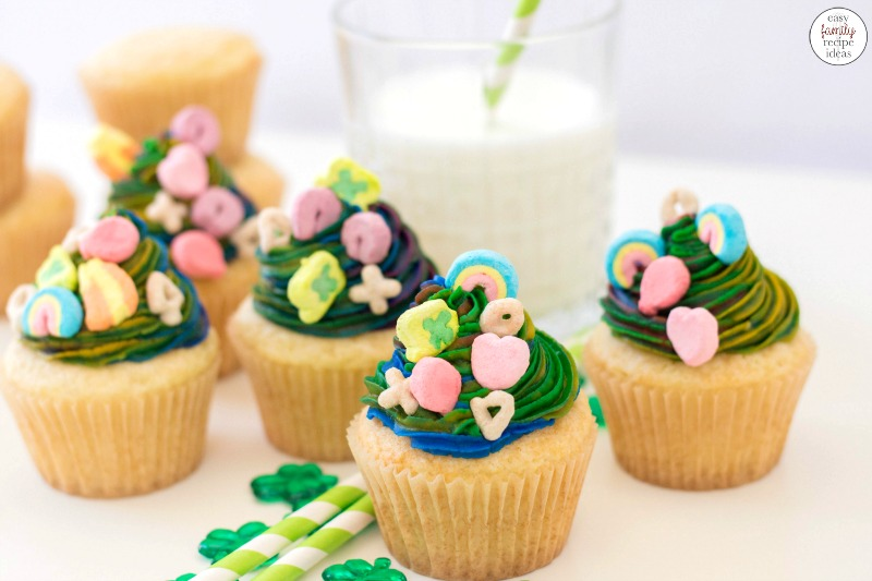 You will make everyone happy with these rainbow colored Lucky Charms Cupcakes for St Patrick's Day! They're unique cupcakes to make and so much fun to decorate! Vanilla cupcakes topped with rainbow buttercream are Simply Perfect for a March Cupcake idea!