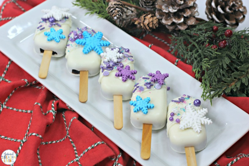 Make The Best Frozen Cakesicles for a Frozen Themed Birthday Party or a Winter Treat for Kids, These decorated Frozen Themed Cakesicles and Frozen Cake Pops are delicious Cakesicles ideas made with boxed cake mix and snowflake sprinkles.