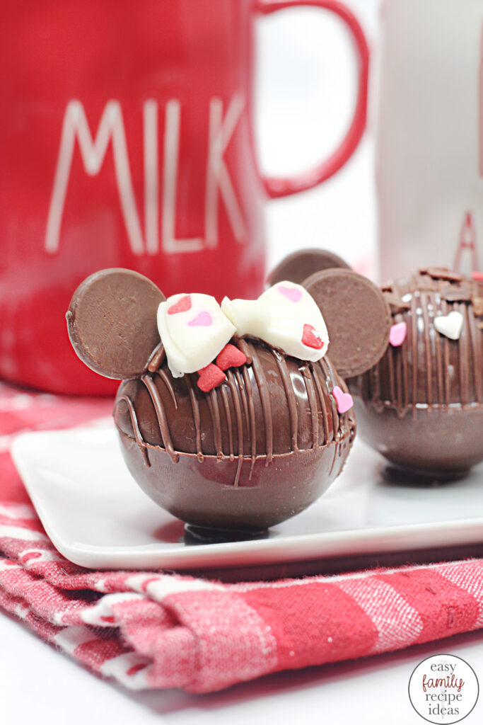 Valentine's Day Mickey Hot Chocolate Bombs, These are the Cutest Minnie and Mickey Hot Cocoa Bombs, so if you are a fan of Disney and want to enjoy a sweet treat, add delicious Disney hot chocolate bombs to your Valentine's Day.