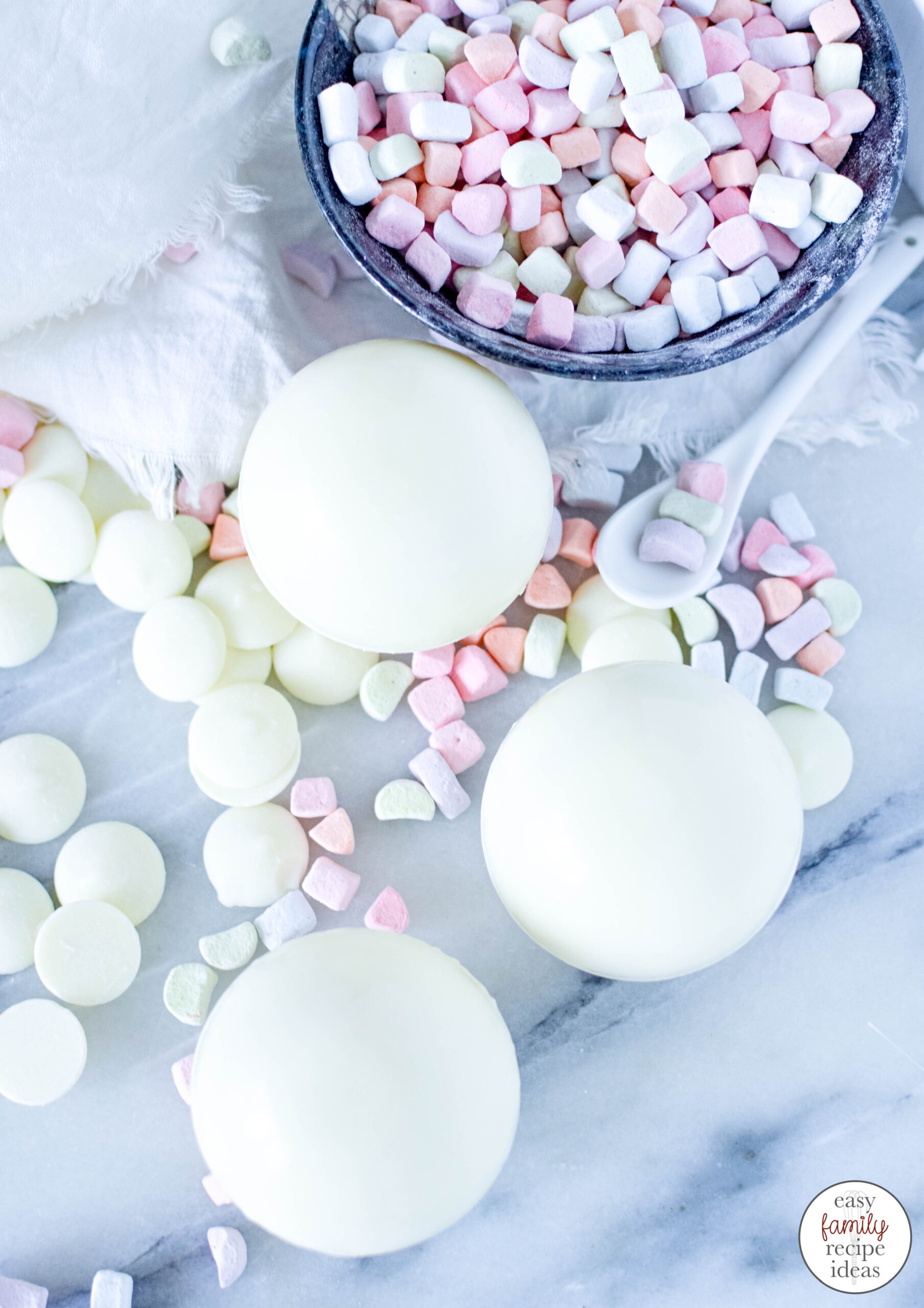 These Hot Cocoa Bombs with Lucky Charms are so good! Learn How to Make Pot of Gold White Chocolate Bomb for St. Patrick's Day or for a Spring Treat, Serve up White Chocolate Hot Chocolate Bombs and St. Patrick's Day Hot Chocolate Bombs to your friends and family